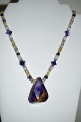 Bolivian Hand Faceted Ametrine