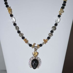 Carved Black Onyx Pendant with Citrine and Golden Rutile Beads.