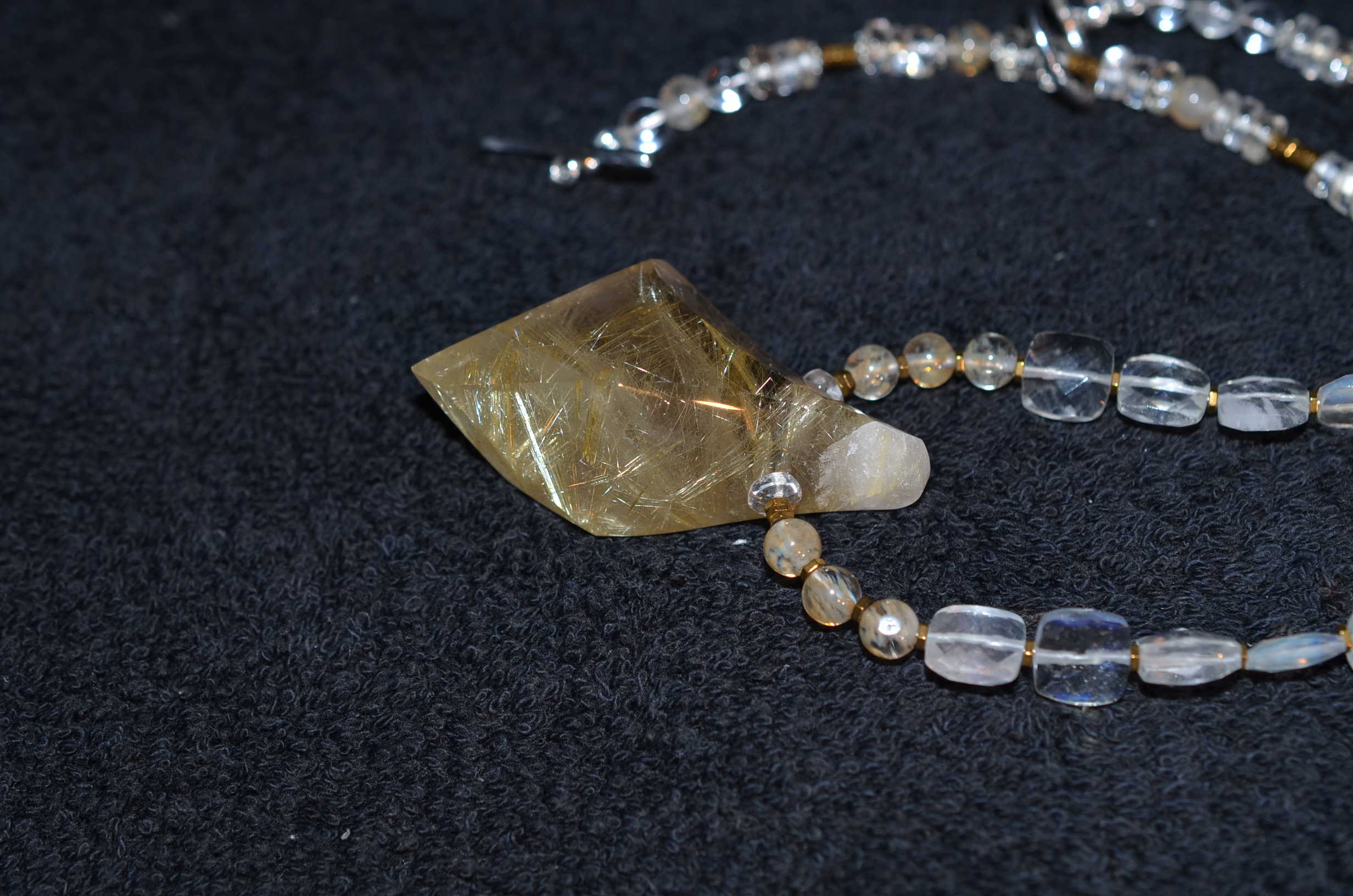 Hand cut golden rutilated quartz pendant a journey for Golden rutilated quartz jewelry